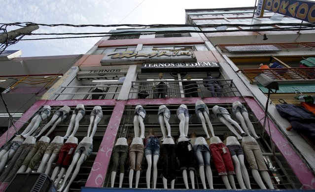 Mannequins are seen at stores of the commercial zone of Gamarra in Lima,April 16, 2015. (Photo by Mariana Bazo/Reuters)