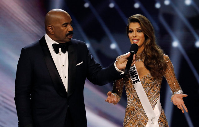 Miss France Iris Mittenaere speaks next to emcee Steve Harvey during the question and answer portion  before winning the 65th Miss Universe beauty pageant at the Mall of Asia Arena, in Pasay, Metro Manila, Philippines January 30, 2017. (Photo by Erik De Castro/Reuters)