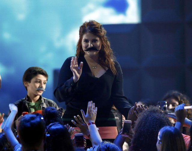 Singer Meghan Trainor wears a fake mustache in the audience at Nickelodeon's 2016 Kids' Choice Awards in Inglewood, California March 12, 2016. (Photo by Mario Anzuoni/Reuters)