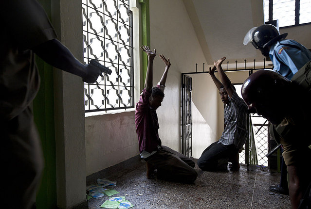 Alleged jihadist youths are apprehended by police during a raid inside the Masjid Mussa mosque in the Majengo area of Mombasa on Febraury 2, 2014. At least one young Muslim man was killed and a police officer seriously wounded today when police raided a mosque in the Kenyan coastal city of Mombasa, a local police chief said. Police said they stormed the Masjid Musa mosque because young men were being radicalised there. (Photo by Ivan Lieman/AFP Photo)