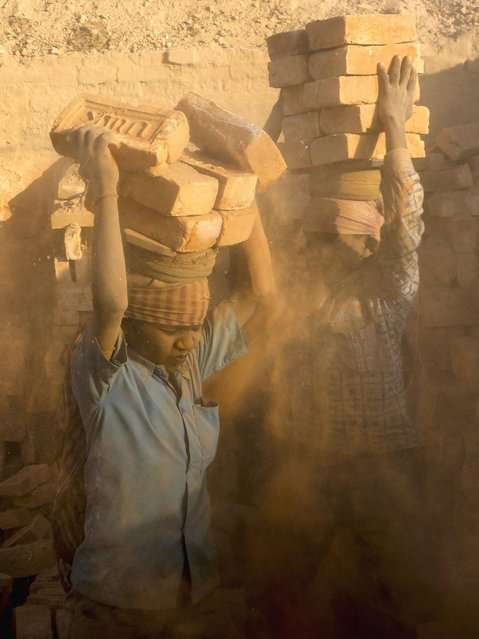 Brick kilns in the Kathmandu Valley pollute the environment, exploit the young children and generally operate away from the public eye. No labour inspector ever visits the kilns to monitor the thousands of migrant labourers. (Photo by Narendra Shrestha/EPA)