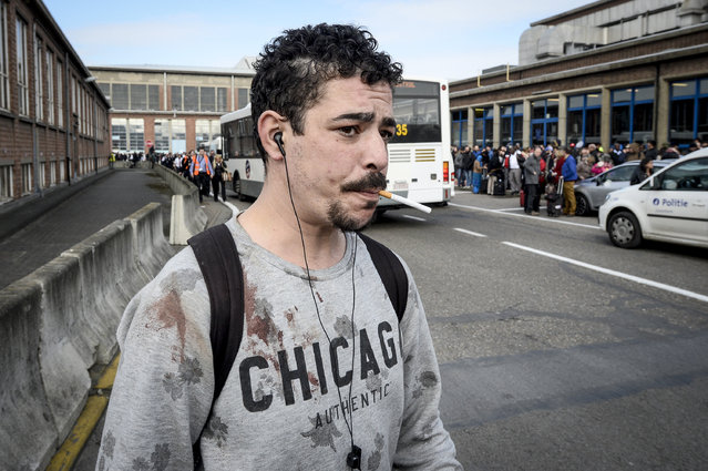 A man with blood on his shirt is evacuated from Brussels Airport in Zaventem, Belgium, on Tuesday, March 22, 2016. (Photo by Dirk Waem/Belga/Zuma Press/TNS)