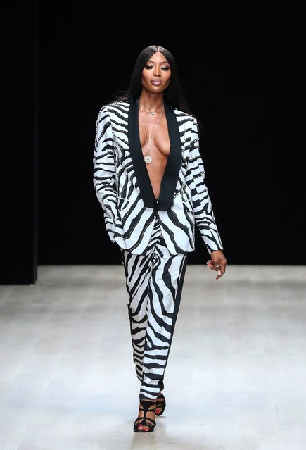 Model Naomi Campbell walks the runway wearing Triple RRR by Robert Cavalli during Arise Fashion Week on April 20, 2019 in Lagos, Nigeria. (Photo by Bennett Raglin/Getty Images)