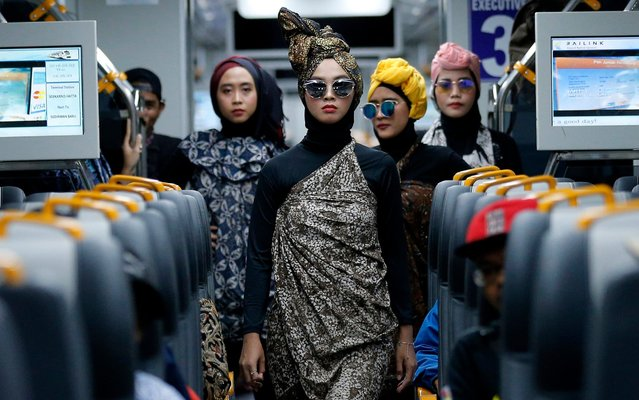 Models perform during a Muslim fashion show an airport train in Jakarta, Indonesia on Thursday, May 2, 2019. The fashion show was held to great to upcoming fasting month of Ramadan, the holiest month in Muslim calendar. (Photo by Tatan Syuflana/AP Photo)