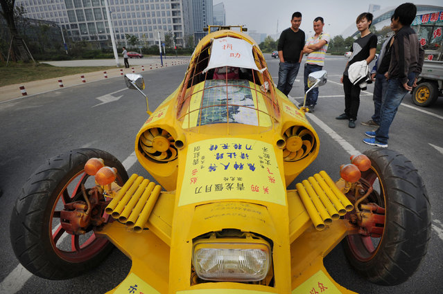 A self-made car built by Zhu Runqiang (not pictured) is seen in Hefei, Anhui province, October 21, 2013. Grassroots inventor Zhu, 47, built the car with components he collected from used vehicles. The car reaches a highest speed of 60km/h, according to local media. (Photo by Reuters/China Daily)