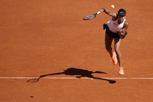 Japan's Naomi Osaka returns the ball during her match against Slovakia's Dominika Cibulkova during the Madrid Open tennis tournament, Sunday, May 5, 2019, in Madrid, Spain. (Photo by Andrea Comas/AP Photo)