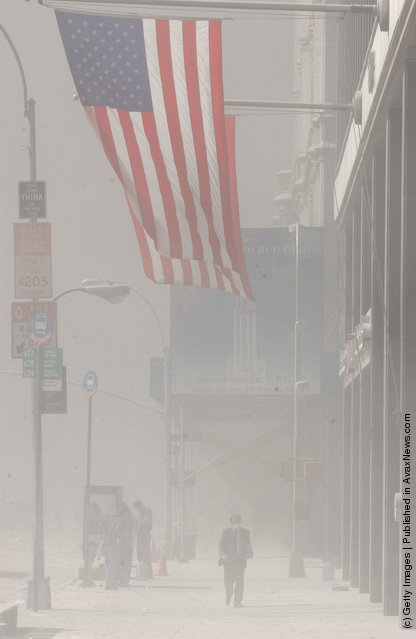 Dust swirls around south Manhattan moments after a tower of the World Trade Center collapsed September 11, 2001