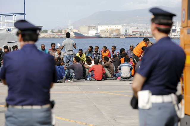 Migrants are disembarked from the Migrant Offshore Aid Station (MOAS) ship MV Phoenix in the Sicilian harbour of Messina, Italy May 16, 2015. (Photo by Antonio Parrinello/Reuters)