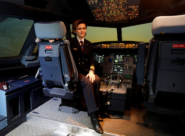 """Pilot Maria Uvarovskaya poses for a photograph in the A320 flight simulator at the Aeroflot training centre at Sheremetyevo airport outside Moscow, Russia, February 20, 2017. """"Much more can be done by the women themselves to solve such problems (gender inequality)"""", said Uvarovskaya. (Photo by Grigory Dukor/Reuters)"""