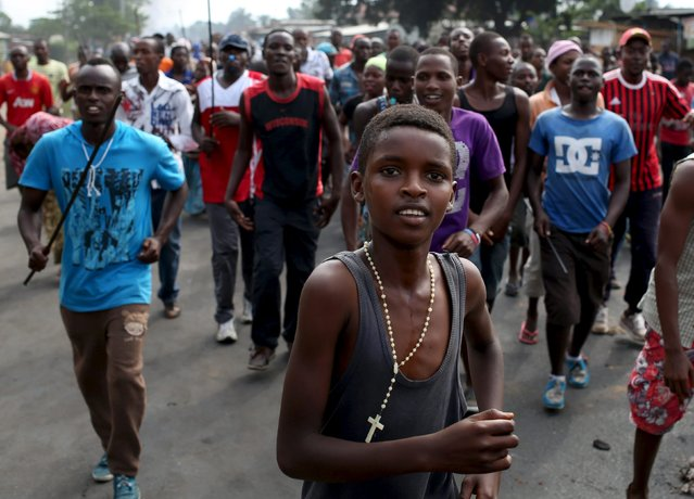 Protesters walk on a street during a protest against President Pierre Nkurunziza and his bid for a third term in Bujumbura, Burundi, May 25, 2015. (Photo by Goran Tomasevic/Reuters)