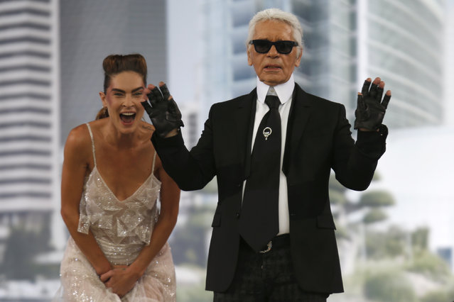 German designer Karl Lagerfeld appears with models at the end of his Haute Couture Fall Winter 2013/2014 fashion show for French fashion house Chanel in Paris July 2, 2013. (Photo by Charles Platiau/Reuters)