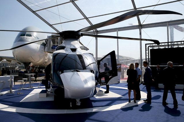 Visitors look at a H160 of Airbus Helicopters on display during the 51st Paris Air Show at Le Bourget airport near Paris June 17, 2015. REUTERS/Pascal Rossignol