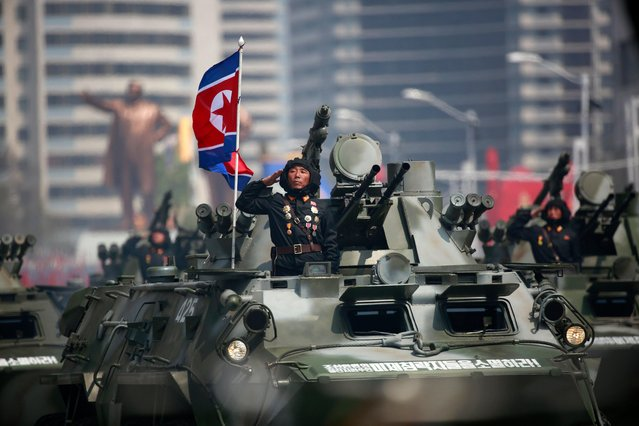 "North Korean soldiers on military armoured vehicles drive past during a parade for the ""Day of the Sun"" festival on Kim Il Sung Square in Pyongyang, North Korea, 15 April 2017. North Koreans celebrate the ""Day of the Sun"" festival commemorating the 105th birthday anniversary of former supreme leader Kim Il-sung on 15 April as tension over nuclear issues rise in the region. (Photo by How Hwee Young/EPA)"