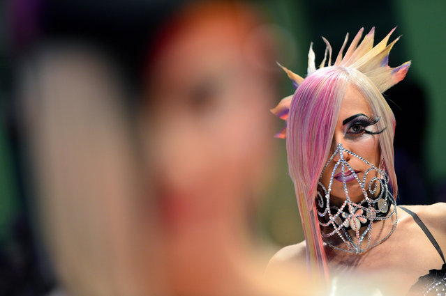 """Models walke around the catwalk after the contest """"Full Fashion Look"""" during the OMC Hairworld World Cup on May 4, 2014 in Frankfurt am Main, Germany. (Photo by Thomas Lohnes/Getty Images)"""