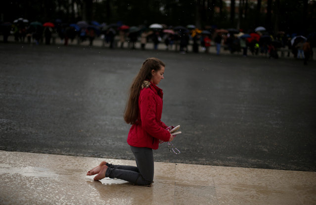 A pilgrim walks on her knees to fulfil her vows, as pilgrims attend the 99th anniversary of the appearance of the Virgin Mary to three shepherd children, at the Catholic shrine of Fatima, Portugal May 12, 2016. (Photo by Rafael Marchante/Reuters)