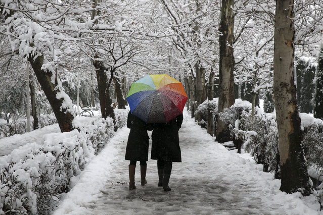 Two Iranians walk in Laleh Park in central Tehran, Iran, Sunday, January 28, 2018. (Photo by Vahid Salemi/AP Photo)