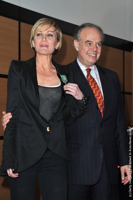 Patricia Kaas poses with French culture Minister, Frederic Mitterrand after being honored at Hotel Majestic