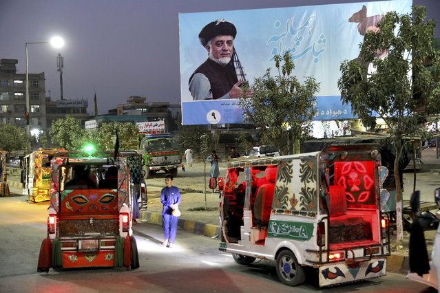 In this Monday, September 23, 2019 photo, a poster of presidential candidate Abdullah Abdullah is displayed on a street on the outskirts of Kabul, Afghanistan. Millions of Afghans are expected to go to the polls on Saturday to elect a new president, despite an upsurge of violence in the weeks since the collapse of a U.S.-Taliban deal to end America's longest war, and the Taliban warning voters to say away from the polls. (Photo by Ebrahim Noroozi/AP Photo)