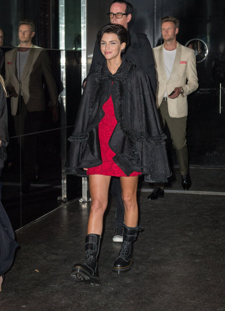 Ruby Rose spotted rocking a suede poncho over a red dress and boots as she leaves a party in New York City, New York, USA on May 1, 2017. (Photo by @PapCultureNYC/Splash News and Pictures)
