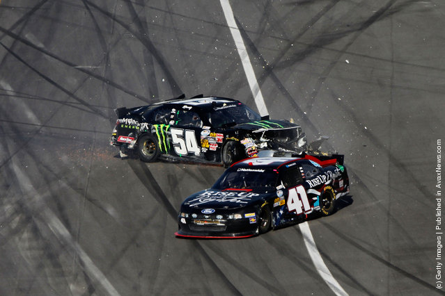 Kyle Busch, driver of the #54 Monster Energy Toyota, and Blake Koch, driver of the #41 Rise Up and Register Ford, spin after being involved in a last lap on track incident during the NASCAR Nationwide Series DRIVE4COPD 300 at Daytona International Speedway