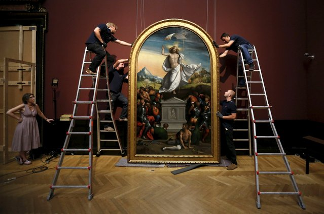 Craftsmen adjust Italian artist Benvenuto Tisi's (or Il Garofalo) painting Ascension of Christ, which has been under restoration for two years, in the Art History Museum (Kunsthistorisches Museum Wien) in Vienna, Austria, July 21, 2015. The paining dated 1520 will be on exhibition in the museum's picture gallery. (Photo by Leonhard Foeger/Reuters)