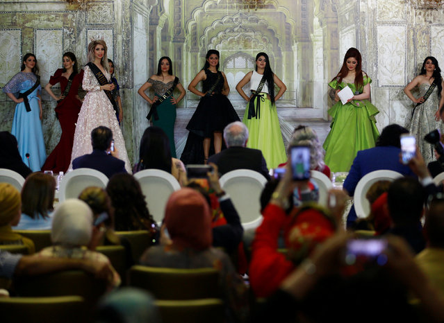 Participants wait for judges to determine the winner of Miss Iraq during the final round of judging in Baghdad,Iraq May 25, 2017. (Photo by Thaier Al-Sudani/Reuters)