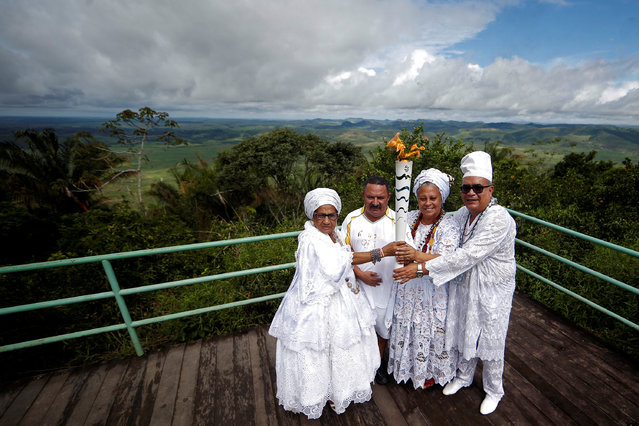 Resident Francisco Neto (2nd L) takes part in the Olympic Flame torch relay at mountain range Serra da Barriga in Uniao dos Palmares, Alagoas state, Brazil, May 30, 2016. (Photo by Fernando Soutello/Reuters/Courtesy of Rio2016)