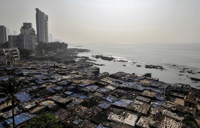 A view of a slum is seen along a seashore in Mumbai, November 28, 2019. Picture taken November 28, 2019. (Photo by Prashant Waydande/Reuters)