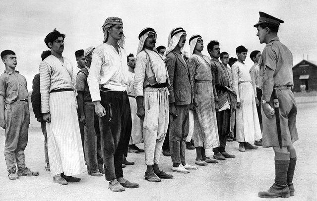 These Arab recruits line up in a barracks square in the British Mandate of Palestine, on December 28, 1940, for their first drill under a British solider. Some 6,000 Palestinian Arabs signed up with the British Army during the course of World War II