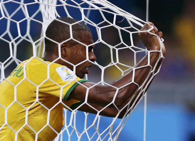 Brazil's Fernandinho reacts in his goal's net after they conceded a goal to Germany during their 2014 World Cup semi-finals at the Mineirao stadium in Belo Horizonte July 8, 2014. (Photo by Marcos Brindicci/Reuters)