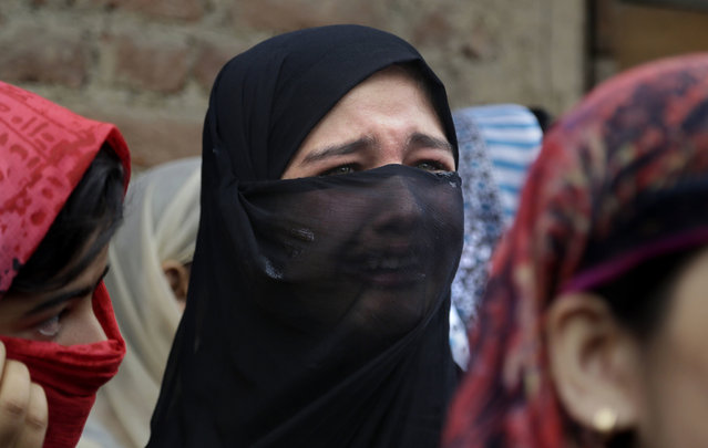 A Kashmiri woman cries during the funeral procession of local rebel Aqib Ahmad in Srinagar, Indian controlled Kashmir, Wednesday, July 12, 2017. (Photo by Mukhtar Khan/AP Photo)