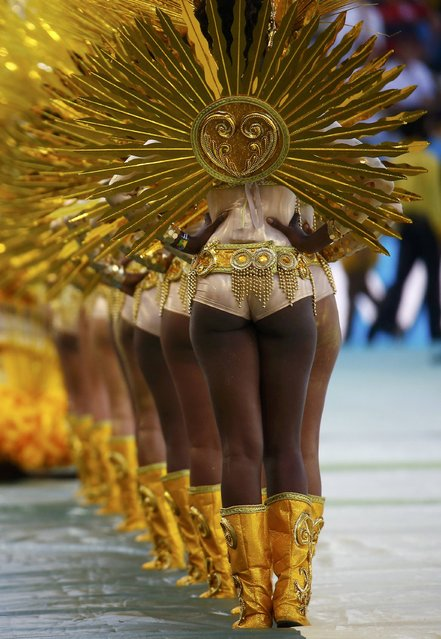 Performers dance during the 2014 World Cup closing ceremony at the Maracana stadium in Rio de Janeiro July 13, 2014. (Photo by Kai Pfaffenbach/Reuters)