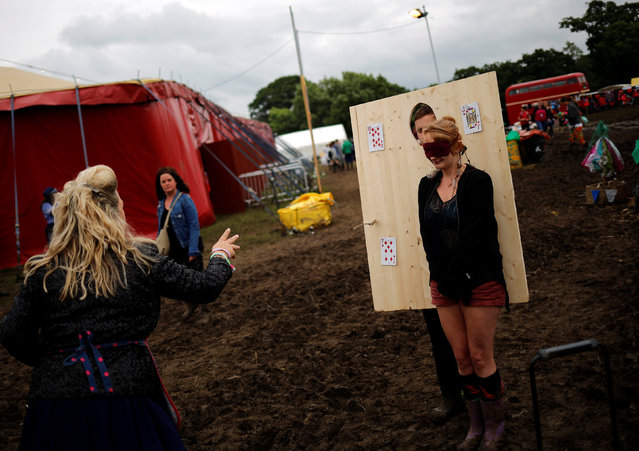 An actor entertains the revellers at Worthy Farm in Somerset during the Glastonbury Festival, Britain, June 26, 2016. (Photo by Stoyan Nenov/Reuters)