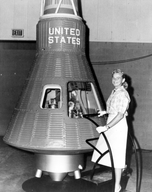 Jerrie Cobb poses next to a Mercury spaceship capsule. Although she never flew in space, Cobb, along with 24 other women, underwent physical tests similar to those taken by the Mercury astronauts with the belief that she might become an astronaut trainee. (Photo by NASA)