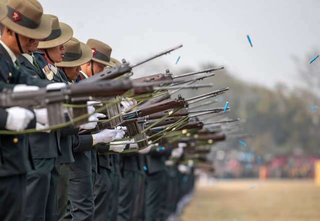 Nepalese Army soldiers fire during the grand rehearsal for Army Day celebrations in Kathmandu, Nepal, 18 February 2020. The Nepalese Army has been active since 1744 and is made up of about 95,000 army infantry and air service members. (Photo by Narendra Shrestha/EPA/EFE)