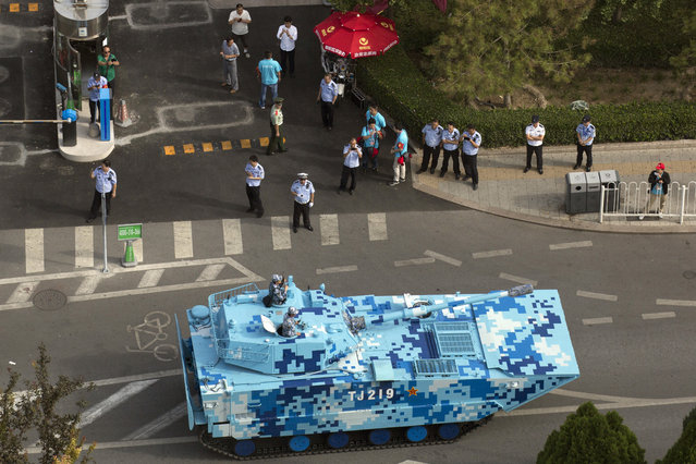 A Chinese military vehicle leaves after rehearsals ahead of the Sept. 3 military parade to commemorate the end of World War II in Beijing, Sunday, August 23, 2015. (Photo by Ng Han Guan/AP Photo)