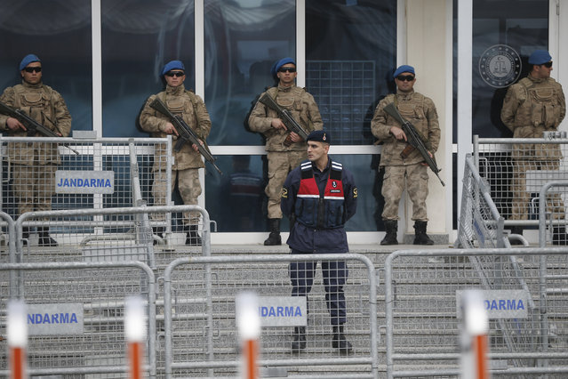 Soldiers stand behind a barricaded entrance of the Silivri courthouse, before the trial of leading members of Turkish civil society, in Silivri, outside Istanbul, Tuesday, February 18, 2020. The trial of 16 leading members of Turkish civil society that is seen by critics as a momentous bid by the government to crack down on opposition voices and criminalize mass anti-government protests is moving toward a hasty conclusion. (Photo by Emrah Gurel/AP Photo)