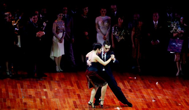 Jonathan Saavedra (R) and Clarisa Aragon from Argentina, who are representing the Argentine city of Cordoba, dance after winning the Tango World Championship in Salon style in Buenos Aires August 26, 2015. (Photo by Marcos Brindicci/Reuters)