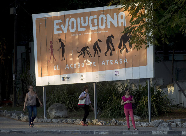 """In this December 9, 2019 photo, a billboard reads in Spanish """"Evolve. Campaign against violence against women. Harassment sets you back"""", in Havana, Cuba. After months of campaigning by women's rights activists, including online campaigns denouncing the murders of at least four women, Cuba this year recognized for the first time that the country had gender-motivated killings. (Photo by Ismael Francisco/AP Photo)"""