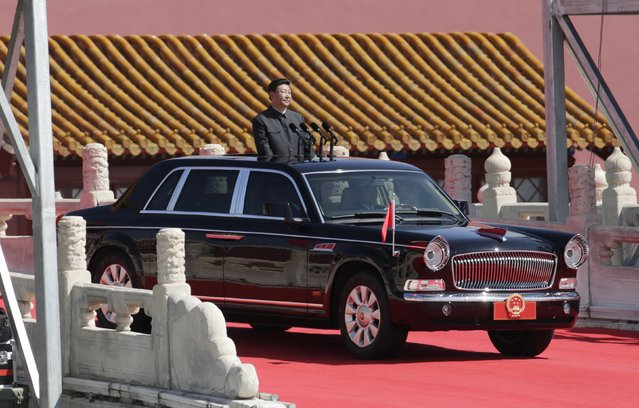 China's President Xi Jinping stands in a car as he inspects troops at a military parade to mark the 70th anniversary of the end of World War Two in Beijing, China, September 3, 2015. (Photo by Jason Lee/Reuters)