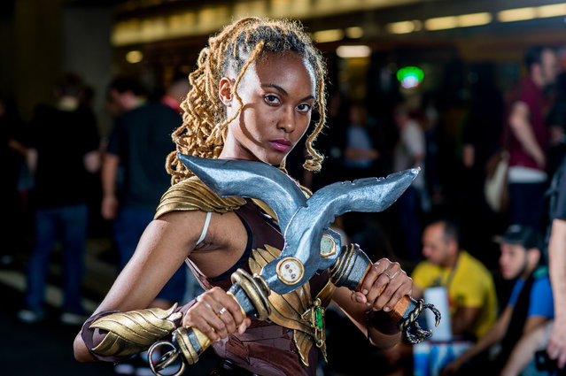 """A fan cosplays as Maya from the video game """"Killer Instinct"""" during 2017 New York Comic Con, Day 2 on October 6, 2017 in New York City. (Photo by Roy Rochlin/WireImage,)"""