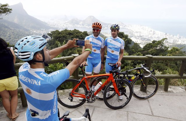 2016 Rio Olympics, Rio de Janeiro, Brazil on August 4, 2016. Cyclist Daniel Diaz (ARG) of Argentina takes a picture of fellow cyclists Maximiliano Richeze (ARG) of Argentina and Eduardo Sepulveda (ARG) of Argentina (L-R). (Photo by Ivan Alvarado/Reuters)