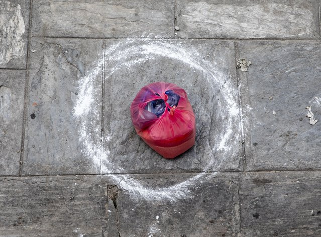 A relief goods kept in a circle distributed by Newa Muslim Society in Kathmandu, Nepal, 15 April 2020. The Newa Muslim Society supplied 50 low income families who have been suffering from continuous lockdown. Nepal has been under a nationwide lock down since 24 March 2020, in an effort to combat the spread of coronavirus. (Photo by Narendra Shrestha/EPA/EFE)
