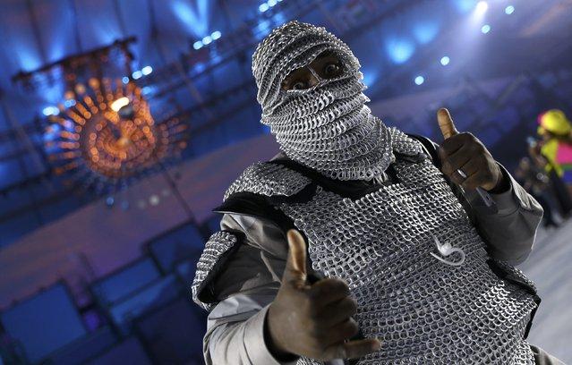 2016 Rio Olympics, Opening ceremony, Maracana, Rio de Janeiro, Brazil on August 5, 2016. A performer poses in front of the Olympic flame during the opening ceremony. (Photo by Kai Pfaffenbach/Reuters)