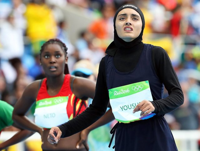 Kamia Yousufi of Afghanistan reacts after competing in the track and field women's 100m heats of the 2016 Rio Olympics, August 12, 2016. (Photo by Srdjan Suki/EPA)