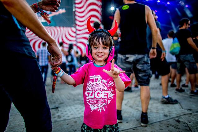 Young festival-goer enjoy on Shipyard Island, the venue of the 24th Sziget (Island) Festival in Northern Budapest, Hungary, 12 August 2016. (Photo by Sandor Csudai/Origo.hu)