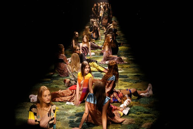 Models sit on the catwalk during Dries van Noten's Spring/Summer 2015 ready-to-wear fashion collection presented in Paris, France, Wednesday, September 24, 2014. (Photo by Jacques Brinon/AP Photo)
