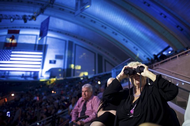 A woman looks towards the stage with binoculars less than five minutes before broadcast of the 95th Miss America Pageant at Boardwalk Hall, in Atlantic City, New Jersey, September 13, 2015. (Photo by Mark Makela/Reuters)