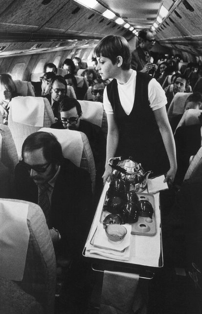 An air hostess serves passengers on board a TU-144. Passengers were first welcomed on board around 1977. (Photo by Miroslav Zajic/Corbis via Getty Images)