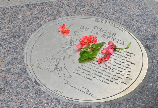 The view of he plaque that celebrates designer Oscar De La Renta, a part of Fashion Walk of Fame along 7th avenue between 35th and 40th streets on October 21, 2014 in New York City. (Photo by Slaven Vlasic/Getty Images)